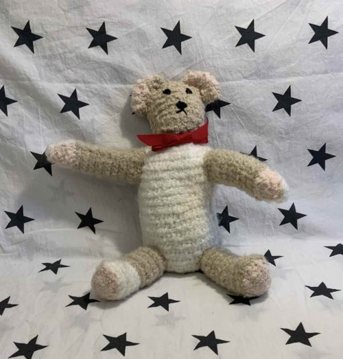 brown crochet teddy with red bow